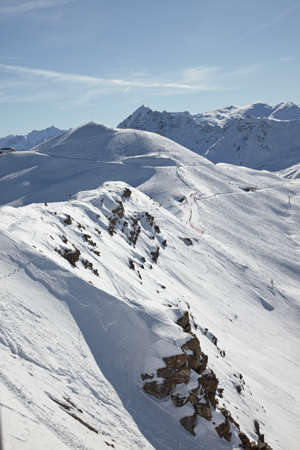 Snowy mountain landscape with ski slopes in the distance Stock Photo - 7838528
