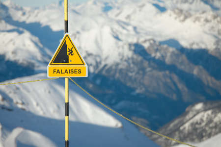 Warning sign and safety rail in the mountains Stock Photo - 7838508