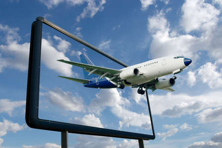 Airliner flying out of a billboard Stock Photo - 7838473