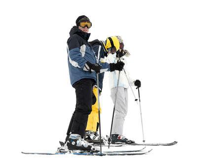 skieer: Groep van jonge skiërs op witte achtergrond Stockfoto