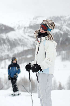 Young female skier laughing photo