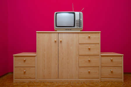 Old TV set on a cabinet photo