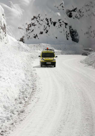 Hard driving condition on mountain road in winter photo