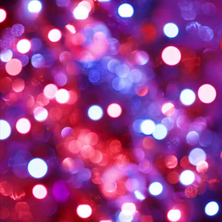 Defocused light dots forming abstract background photo