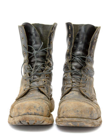 combat boots: A pair of muddy boots
