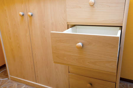 Wooden cabinet with open drawer photo