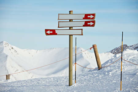 Blank direction signs in a ski resort  photo