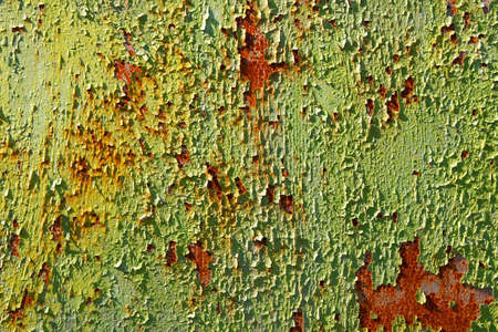 Rusty metal texture with green paint falling apart photo