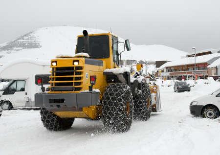 Snowplow machine in winter in an alpine region photo