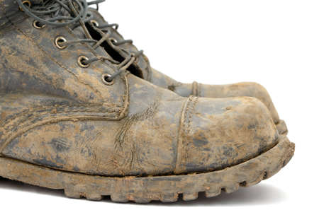 A pair of muddy boots photo