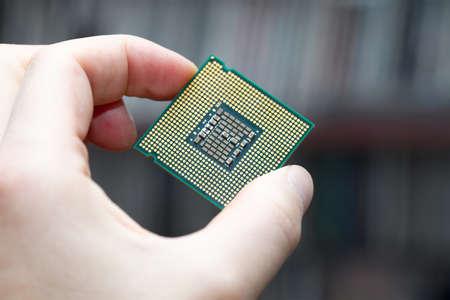 Computer CPU in human hand photo