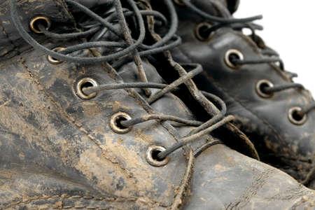 Muddy boots detail photo
