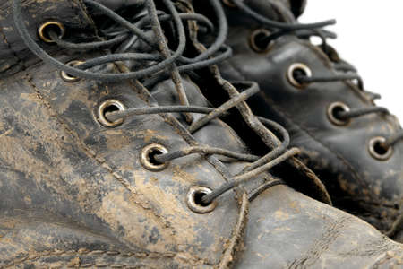 old items: Muddy boots detail Stock Photo