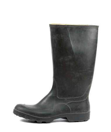 Black rubber boots isolated on white background photo