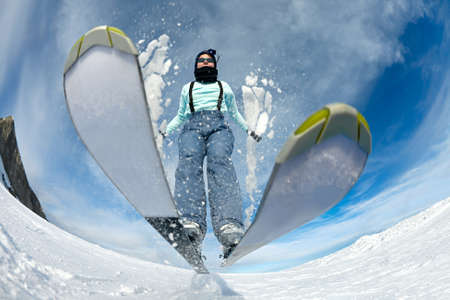 snow ski: Skier jumping on the slope Stock Photo
