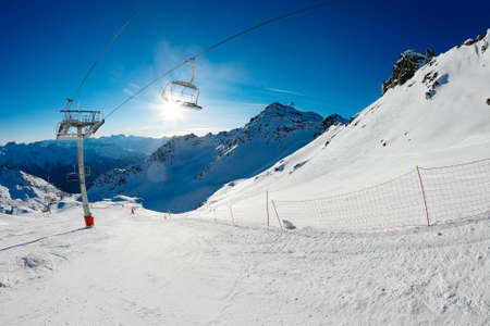 Ski slope with chairlift photo
