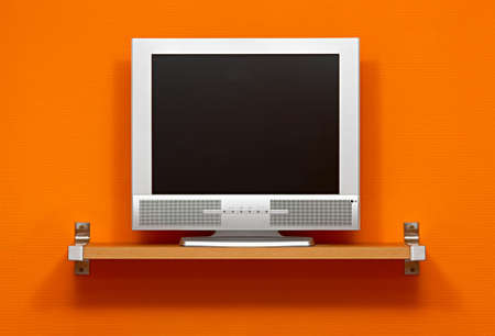 LCD TV against orange wall photo