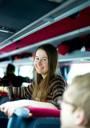 coach bus: Smiling girl traveling by bus Stock Photo