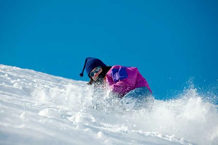 Skier coming down a steep slope photo