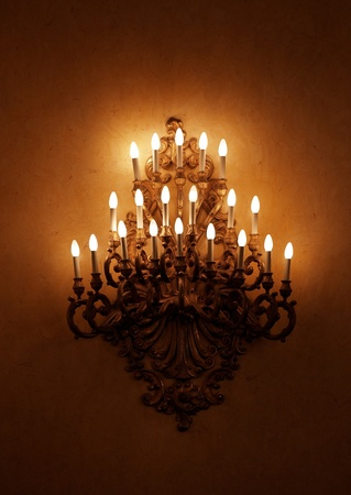 Decorated chandelier in palace hall Stock Photo
