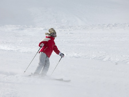 Skier coming down the slope fast Stock Photo - 10772540