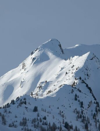 High mountains covered by snow photo