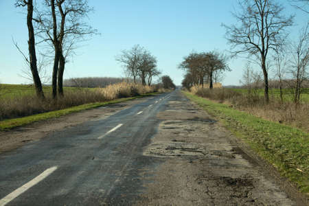 Bad quality road in the countryside photo