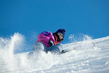 Female skier coming down the slope Stock Photo - 11204760