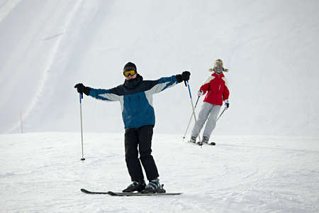 Skiers coming down the track