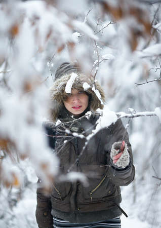 Woman in the deep winter forest photo