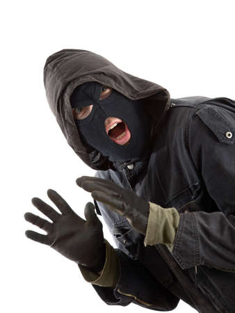 trespasser: Surprised robber in a black mask