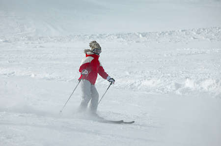 Skier rushing down the slope photo