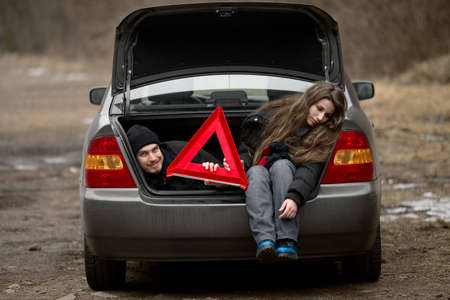 car trouble: Travelers waiting for assistance in a broken car Stock Photo