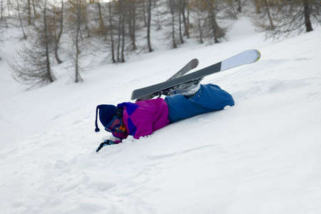 skiing accident: Skier fallen over in the snow