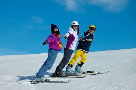 three color: Skiers having fun in winter