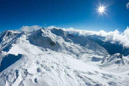 Snowy mountain landscape in sunny weather photo