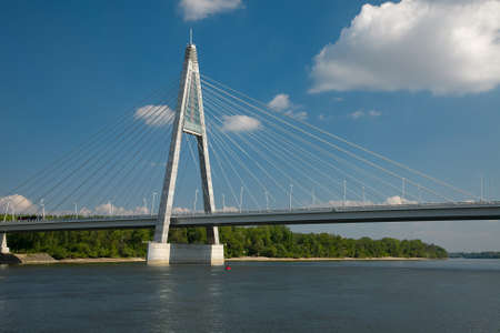 Cable-stayed bridge crossing the river photo