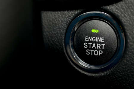 Engine start stop button of a car photo