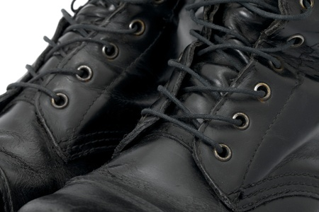 A pair of leather boots closeup photo