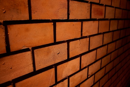 Simple brick wall at night photo