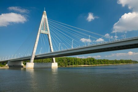 Cable bridge over a river photo