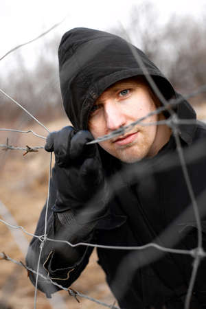 despaired: Hooded man outdoor portrait Stock Photo