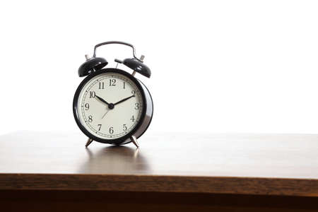 Alarm clock on a table photo