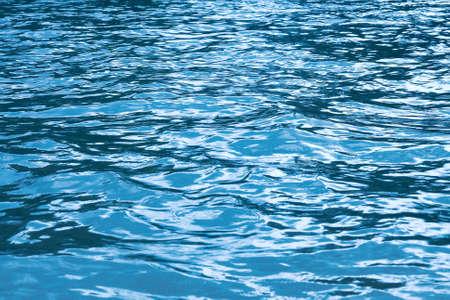 Waving, blue water surface