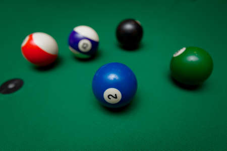 freetime activity: Pool table in game situation Stock Photo