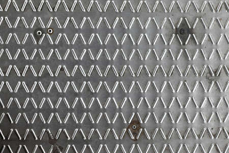 Shiny metal texture with bumps photo