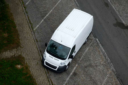 transporter: White van parked in the street