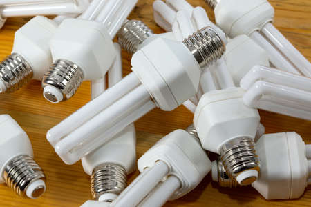 low light: Energy efficient lightbulbs in a pile Stock Photo