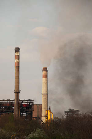 Old, smoking industrial plant Stock Photo - 13418308