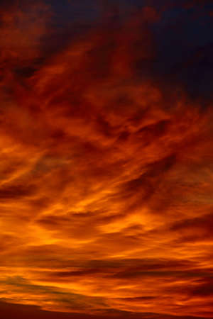 Dramatic sunset sky with clouds glowing red photo